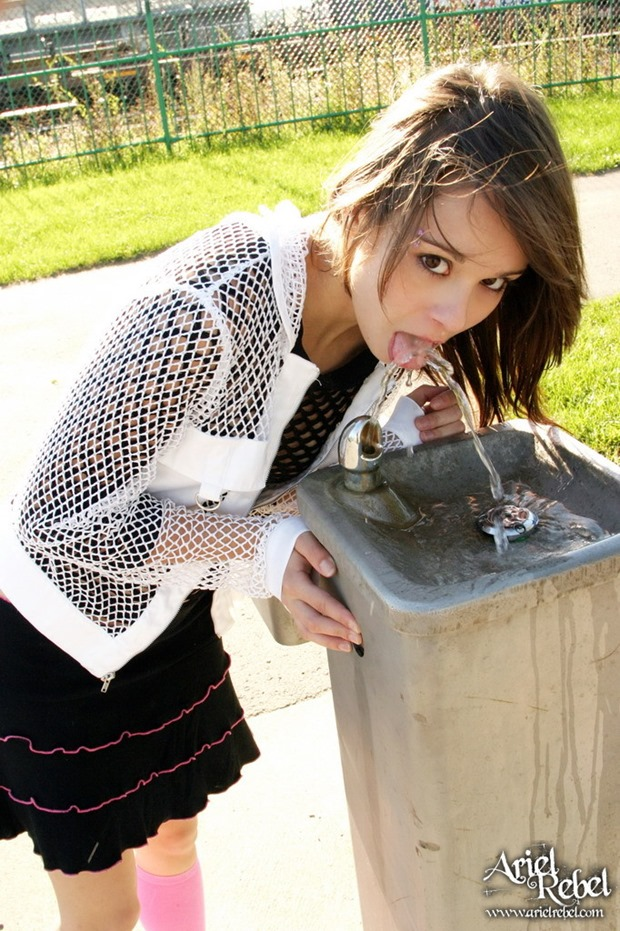 ariel rebel - teen drinking at a water fountain